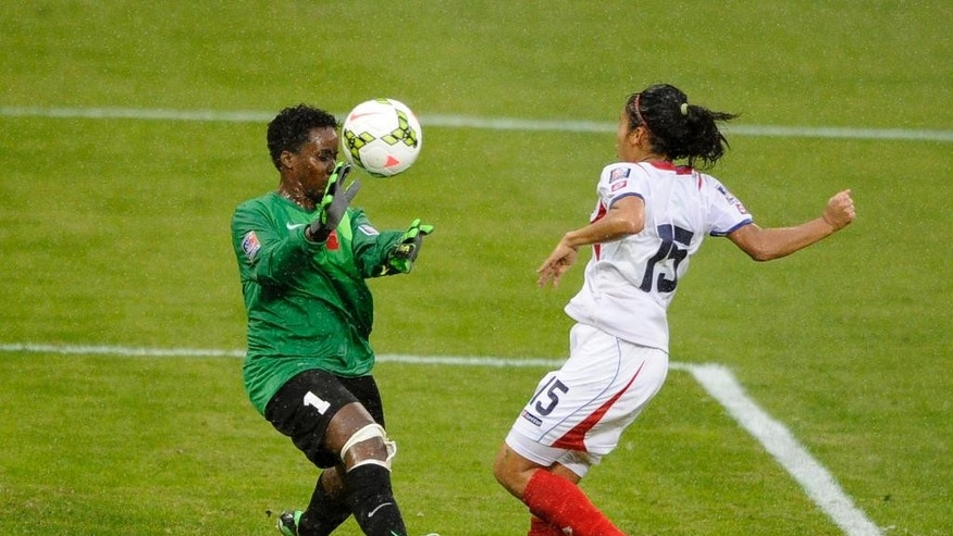 Martinique's Benedicte Hubbel (1) and Costa Rica's Cristin Granados (15) battle for the ball during the first half of a CONCACAF soccer match, at RFK Stadium, Tuesday, Oct. 21, 2014, in Washington. (AP Photo/Nick Wass)