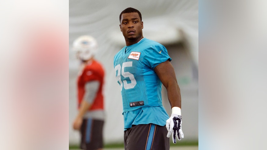 Miami Dolphins defensive end Dion Jordan (95) warms up during an NFL football practice in Davie, Fla., Tuesday, Oct. 21, 2014. Jordan returns to practice for the Miami Dolphins after missing the first six games because he twice violated the NFL's substance abuse policy. (AP Photo/Alan Diaz)