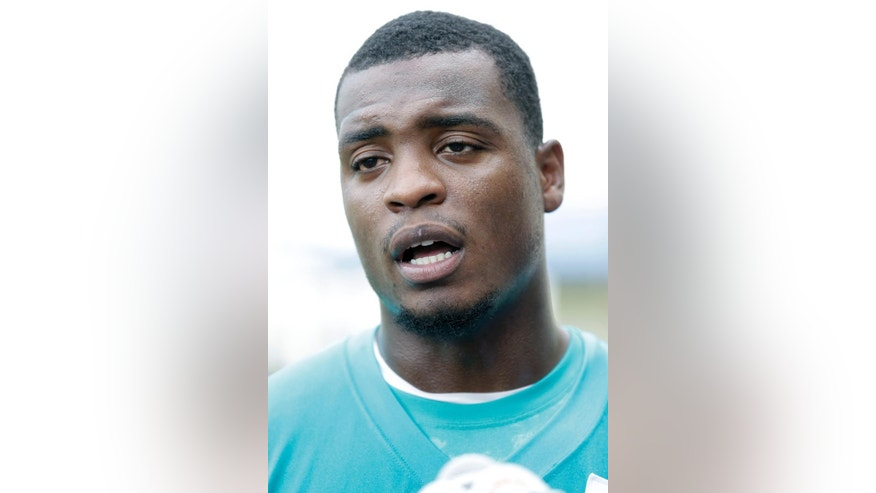 FILE - This June 18, 2014, file photo shows Miami Dolphins defensive end Dion Jordan talking to members of the media at the Dolphins Training Facility in Davie, Fla. Jordan returns to practice for the Dolphins after missing the first six games because he twice violated the NFL's substance abuse policy.(AP Photo/Wilfredo Lee, File)