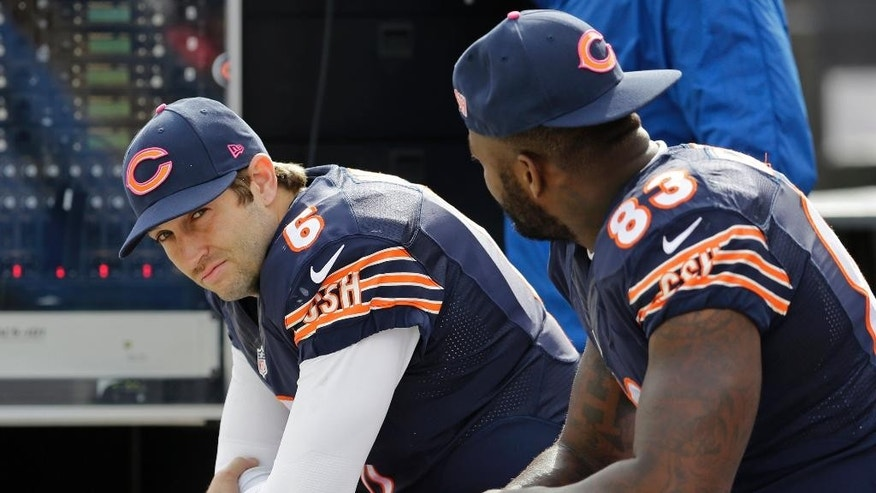 FILE - In this Oct. 19, 2014, file photo, Chicago Bears quarterback Jay Cutler (6) sits on the bench with tight end Martellus Bennett (83) during the second half of an NFL football game against the Miami Dolphins in Chicago. Cutler was pegged as the Bears' savior and instead paid the price for their failure to upgrade the talent around him. (AP Photo/Nam Y. Huh, File)