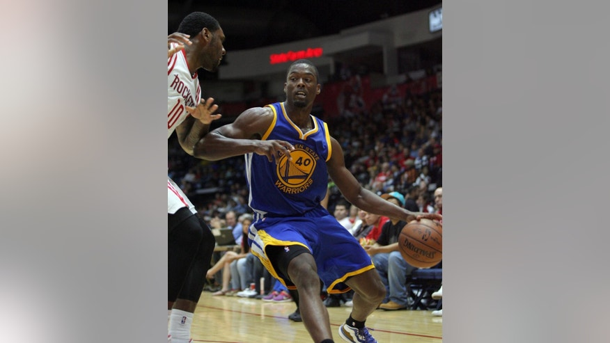 Golden State Warriors' Harrison Barnes is guarded by Houston Rockets' Tarik Black, left, during the second half of an NBA preseason basketball game in Hidalgo, Texas, Sunday, Oct. 19, 2014. (AP Photo/Delcia Lopez)