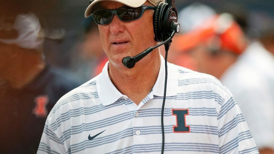 In this Aug. 30, 2014 file photo, Illinois offensive coordinator Bill Cubit watches from the sidelines during a game against the Youngstown State in Champaign, Ill.  With starting quarterback Wes Lunt out until mid-November with an injury, Illini head coach Tim Beckman plans to use a pair of quarterbacks when they host Minnestoa Saturday, Oct. 25. Cubit told reporters he's trying to figure out how he'll use both quarterbacks. (AP  Photo/Bradley Leeb, File)