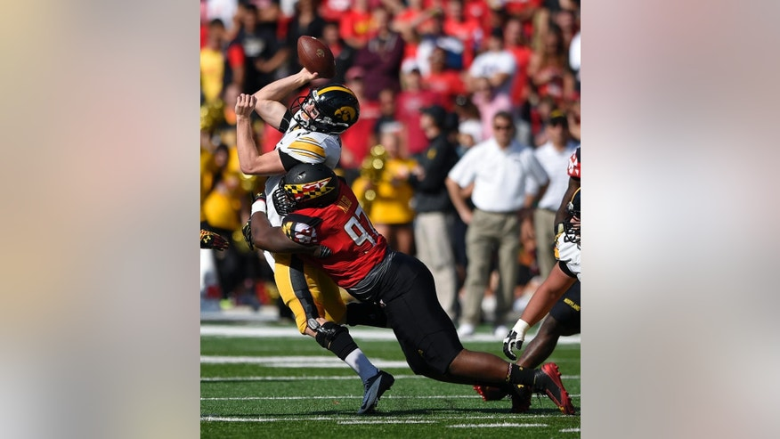 Maryland defensive lineman Darius Kilgo (97) hits Iowa quarterback Jake Rudock (15) during the second half of an NCAA college football game, Saturday, Oct. 18, 2014, in College Park, Md. Maryland won 38-31. (AP Photo/Nick Wass)