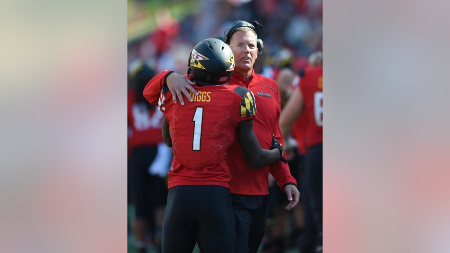Maryland head coach Randy Edsall, right, hugs wide receiver Stefon Diggs (1) after he scored a touchdown during the second half of an NCAA college football game against Iowa, Saturday, Oct. 18, 2014, in College Park, Md. Maryland won 38-31. (AP Photo/Nick Wass)