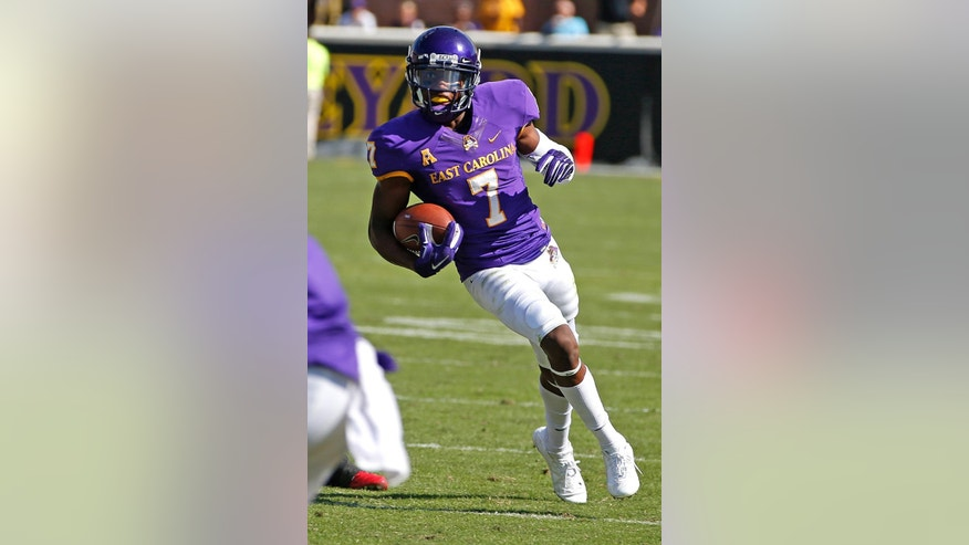 FILE - In this Oct. 4, 2014, file photo, East Carolina wide receiver Isaiah Jones (7) carries the ball during the second half of an NCAA college football game in Greenville, N.C. The development of young receivers has given ECU more options in the passing game. (AP Photo/Karl B DeBlaker, File)