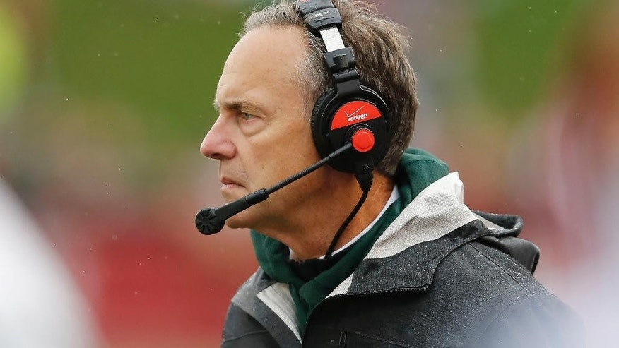Michigan State  head coach Mark Dantonio watches his team during the first half of an NCAA college football game in Bloomington, Ind., Saturday, Oct. 18, 2014. Michigan State won the game 56-17. (AP Photo/Sam Riche)