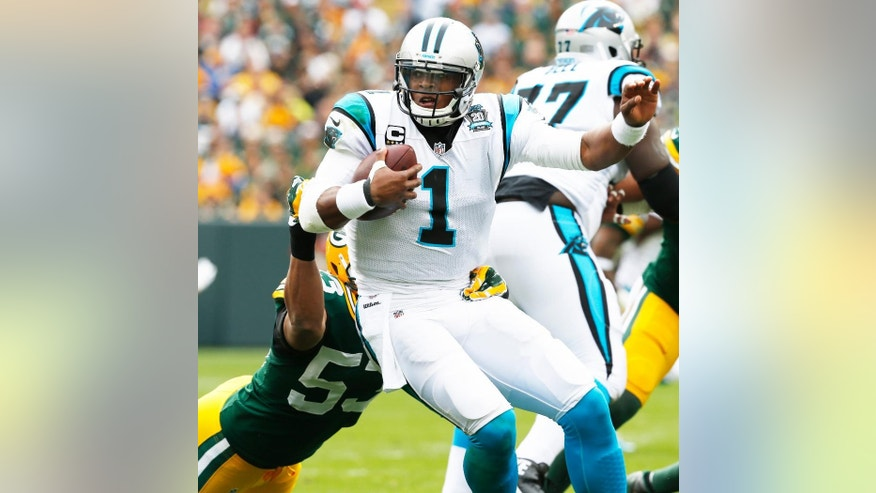 Green Bay Packers' Nick Perry (53) sacks Carolina Panthers quarterback Cam Newton during the first half of an NFL football game Sunday, Oct. 19, 2014, in Green Bay, Wis. (AP Photo/Mike Roemer)