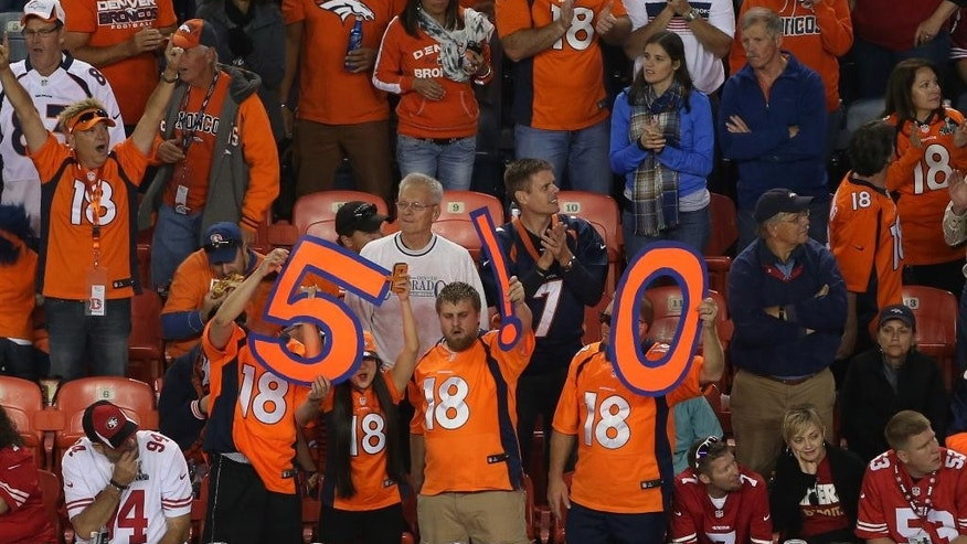Denver Broncos fans hold a 510 sign after Peyton Manning threw his 510th career touchdown pass during the second half of an NFL football game against the San Francisco 49ers, Sunday, Oct. 19, 2014, in Denver.  (AP Photo/David Zalubowski)