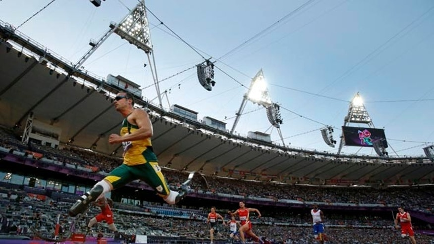 FILE - In this Wednesday, Sept. 5, 2012 file photo South Africa's Oscar Pistorius, left, crosses the line to win his men's 100m T44 category heat during the athletics competition at the 2012 Paralympics in London. (AP Photo/Matt Dunham, File)