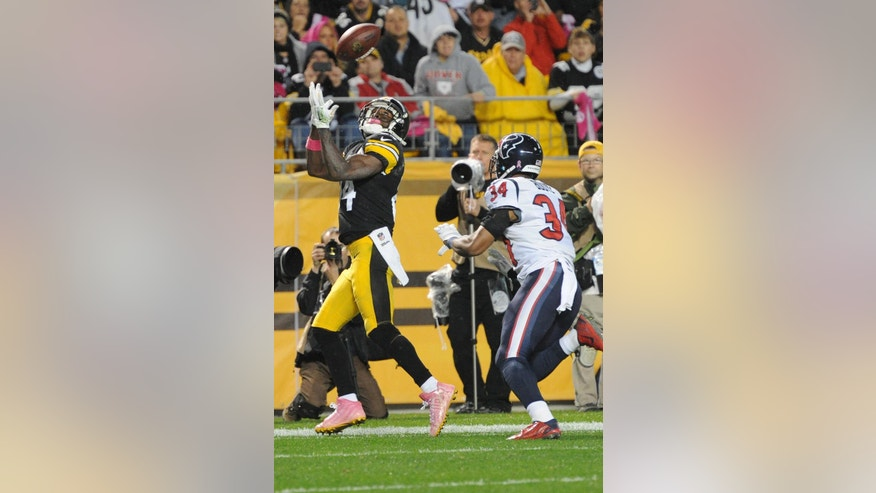 Pittsburgh Steelers wide receiver Antonio Brown (84) tries  to make a catch past Houston Texans cornerback A.J. Bouye (34) in the fourth quarter of the NFL football game against the Pittsburgh Steelers, Monday, Oct. 20, 2014, in Pittsburgh. The catch was ruled out of bounds and overturned on replay. (AP Photo/Don Wright)