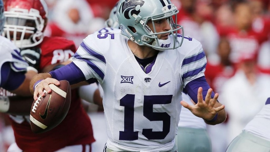 Kansas State quarterback Jake Waters (15) passes in the third quarter of an NCAA college football game against Oklahoma in Norman, Okla., Saturday, Oct. 18, 2014. Kansas State won 31-30. (AP Photo/Sue Ogrocki)