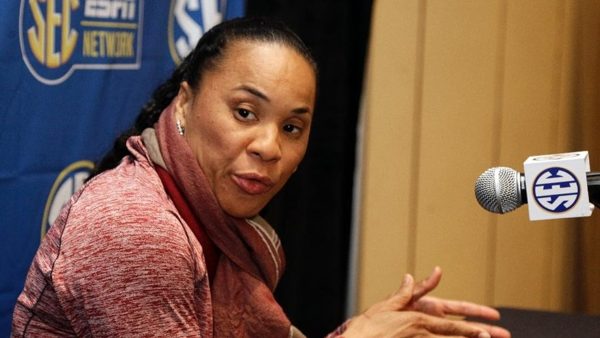 South Carolina head coach Dawn Staley answers a question during a news conference at the Southeastern Conference women's basketball media day in Charlotte, N.C., Tuesday, Oct. 21, 2014. (AP Photo/Chuck Burton)