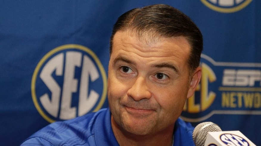 Kentucky head coach Matthew Mitchell answers a question during a news conference at the Southeastern Conference women's basketball media day in Charlotte, N.C., Tuesday, Oct. 21, 2014. (AP Photo/Chuck Burton)