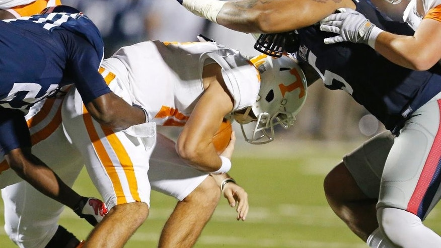 Tennessee quarterback Justin Worley is sacked by Mississippi defensive tackle Robert Nkemdiche, right, in the first half of an NCAA college football game in Oxford, Miss., Saturday, Oct. 18, 2014. (AP Photo/Rogelio V. Solis)