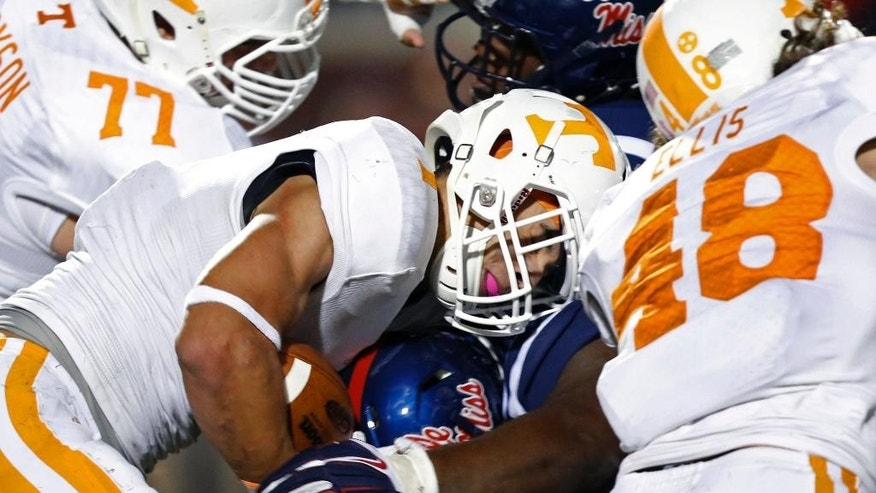 Tennessee running back Jalen Hurd (1) is tackled at the line of scrimmage by Mississippi defensive tackle Woodrow Hamilton in the second half of an NCAA college football game in Oxford, Miss., Saturday, Oct. 18, 2014. No. 3 Mississippi won 34-3. (AP Photo/Rogelio V. Solis)