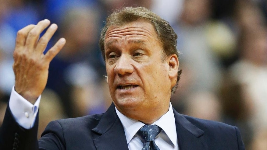 Minnesota Timberwolves head coach Flip Saunders gestures to an official in the first quarter of an NBA preseason basketball game against the Oklahoma City Thunder in Tulsa, Okla., Sunday, Oct. 19, 2014. (AP Photo/Sue Ogrocki)