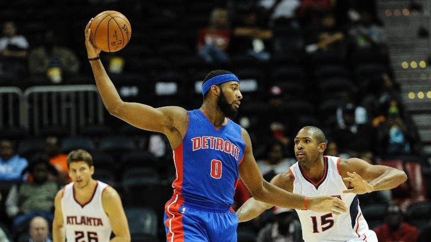 Detroit Pistons center Andre Drummond (0) keeps the ball away from Atlanta Hawks forward Al Horford (15) during the second half of a preseason NBA basketball game, Saturday, Oct., 18, 2014, in Atlanta. Detroit won 104-100. (AP Photo/John Amis)