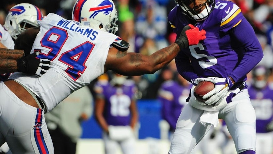 Buffalo Bills defensive end Mario Williams (94) sacks Minnesota Vikings quarterback Teddy Bridgewater (5) during the first half of an NFL football game Sunday, Oct. 19, 2014, in Orchard Park, N.Y.  (AP Photo/Gary Wiepert)