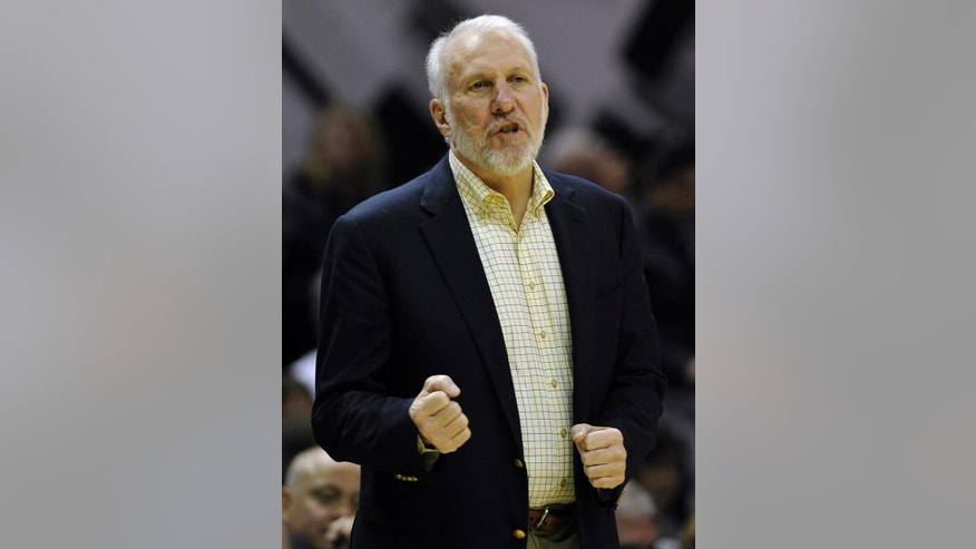 San Antonio Spurs coach Gregg Popovich gestures during the second half of a preseason NBA basketball game against the Miami Heat, Saturday, Oct. 18, 2014, in San Antonio. Miami won 111-108 in overtime. (AP Photo/Darren Abate)