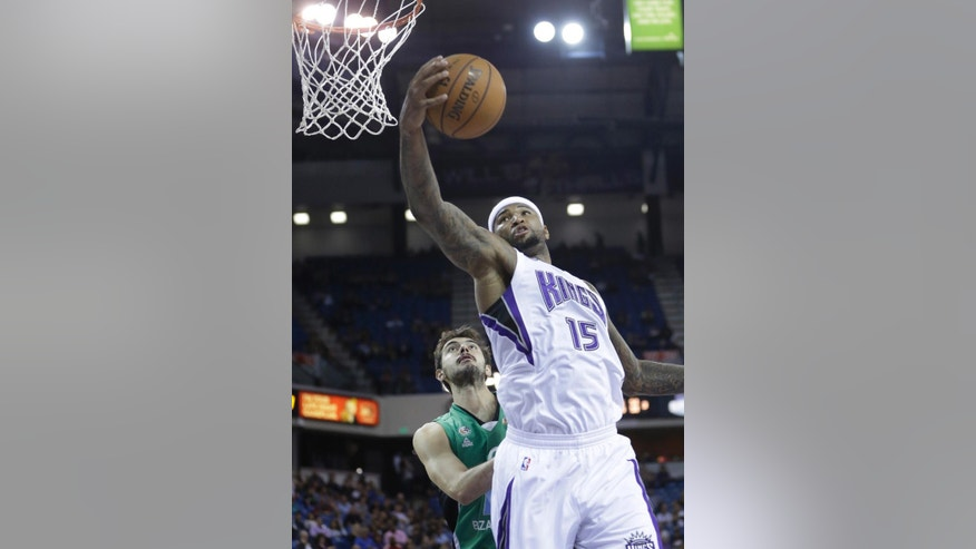Sacramento Kings center DeMarcus Cousins, right, grabs a rebound against Maccabi Haifa center Anton Shoutvin during the third quarter of an NBA exhibition basketball game in Sacramento, Calif., Saturday, Oct. 18, 2014.  The Kings won 91-59.(AP Photo/Rich Pedroncelli)