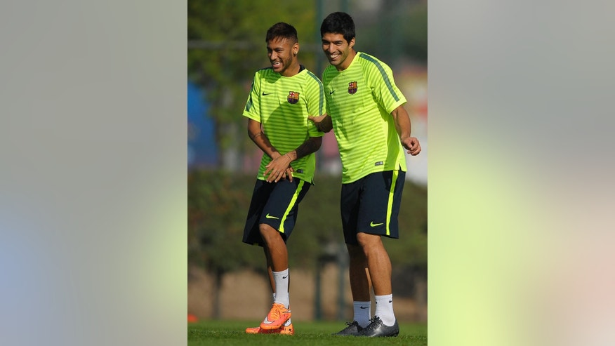 FC Barcelona's Luis Suarez, from Uruguay, right, and Neymar, from Brazil, attend a training session at the Sports Center FC Barcelona Joan Gamper in San Joan Despi, Spain, Monday, Oct. 20, 2014. FC Barcelona will play against Ajax in a group F Champions League on Tuesday Oct. 21. (AP Photo/Manu Fernandez)