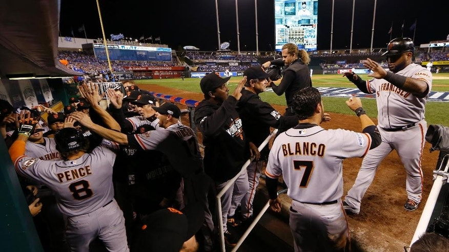 San Francisco Giants Hunter Pence (8) is congratulated by his teammates after hitting a two-run home run during the first inning of Game 1 of baseball's World Series Tuesday, Oct. 21, 2014, in Kansas City, Mo. Right is San Francisco Giants third baseman Pablo Sandoval is scored on Pence's hit. (AP Photo/Matt Slocum )