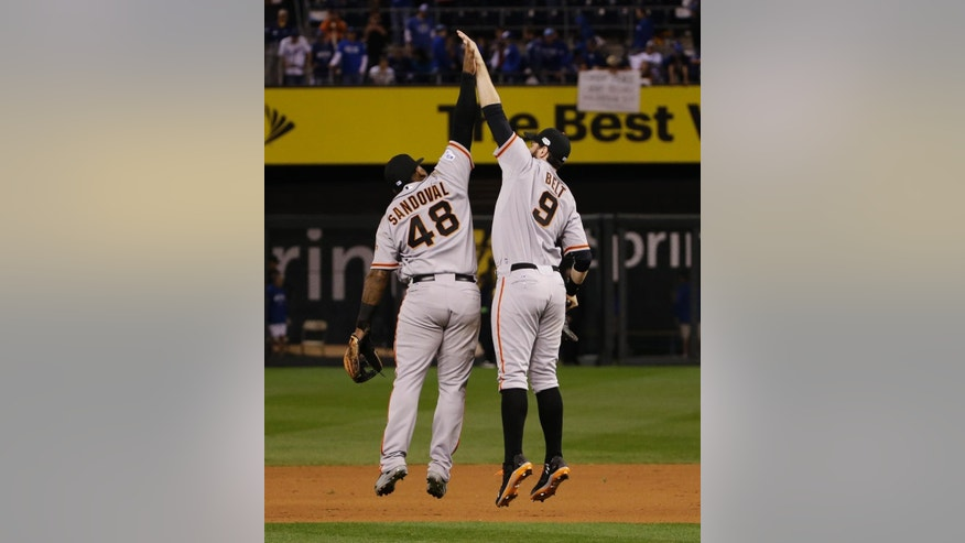 San Francisco Giants third baseman Pablo Sandoval (48) and teammate Brandon Belt celebrate following their 7-1 victory over the Kansas City Royals in Game 1 of baseball's World Series Tuesday, Oct. 21, 2014, in Kansas City, Mo. (AP Photo/Matt Slocum )