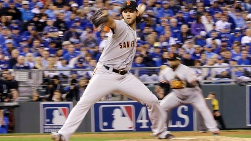October 21, 2014: San Francisco Giants pitcher Madison Bumgarner throws during the fifth inning of Game 1 of baseball's World Series against the Kansas City Royals. (AP Photo/David J. Phillip)