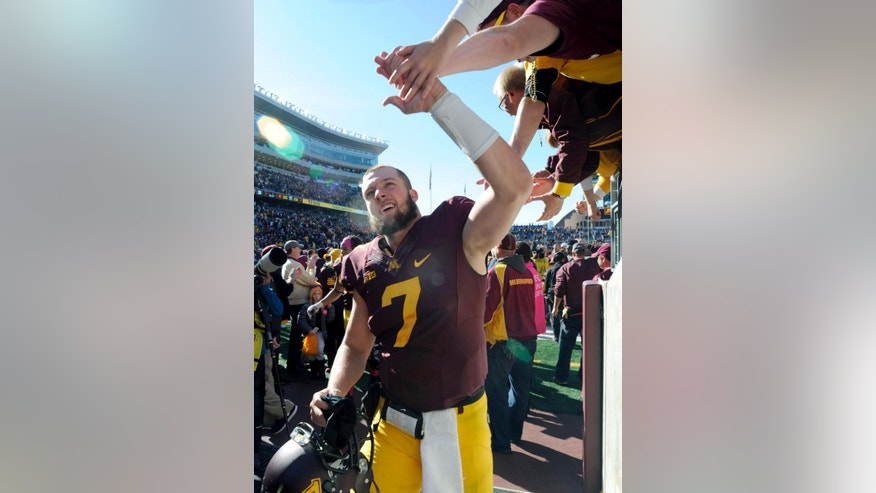 Minnesota defensive back Damarius Travis (7) celebrates a win after an NCAA college football game against Purdue, Saturday, Oct. 18, 2014, in Minneapolis. Minnesota won 39-38. (AP Photo/Hannah Foslien)