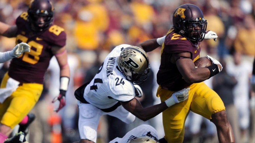 Purdue defensive back Frankie Williams (24) and safety Taylor Richards (4) tackle Minnesota running back David Cobb (27) during the second half of an NCAA college football game Saturday, Oct. 18, 2014, in Minneapolis. Minnesota won 39-38. (AP Photo/Hannah Foslien)