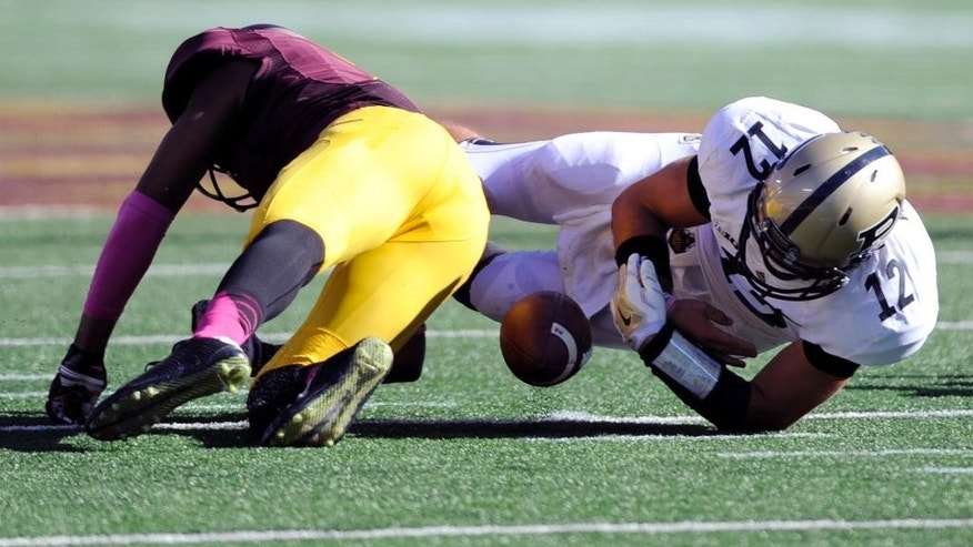 Minnesota defensive back Damarius Travis forces a fumble by Purdue quarterback Austin Appleby (12) on during the second half an NCAA college football game Saturday, Oct. 18, 2014, in Minneapolis. Minnesota won 39-38. (AP Photo/Hannah Foslien)