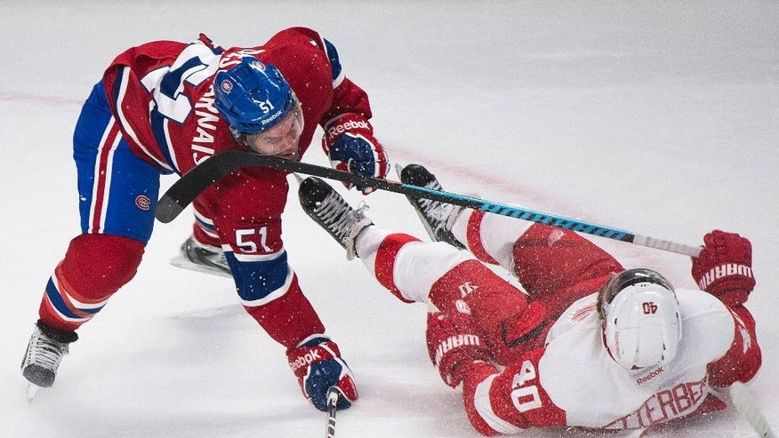 CORRECTS YEAR TO 2014 01Montreal Canadiens' David Desharnais (51) collides with Detroit Red Wings' Henrik Zetterberg during first period NHL hockey action in Montreal, Tuesday, Oct. 21, 2014. (AP Photo/The Canadian Press, Graham Hughes)