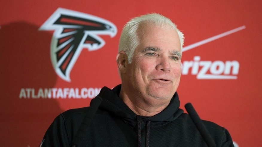 Atlanta Falcons head coach Mike Smith speaks during a press conference at The Grove Hotel in Watford England, Wednesday Oct. 22, 2014. The Falcons will play the Detroit Lions in an NFL football game at London's Wembley Stadium on Sunday, Oct. 26. (AP Photo/Tim Ireland)