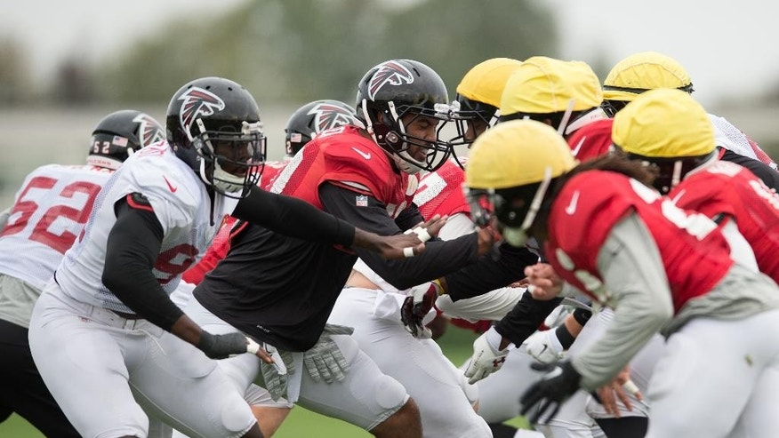 Atlanta Falcons players practice a play during a training session at the Arsenal FC training ground in London Colney, England, Wednesday Oct. 22, 2014. The Falcons will play the Detroit Lions in an NFL football game at London's Wembley Stadium on Sunday, Oct. 26. (AP Photo/Tim Ireland)