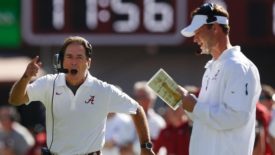 Alabama head coach Nick Saban, left, yells during the first half of an NCAA college football game against Texas A&M, Saturday, Oct, 18, 2014, in Tuscaloosa, Ala. (AP Photo/Brynn Anderson)
