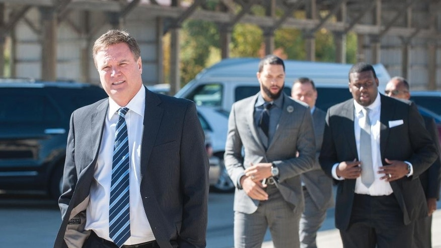 Kansas basketball coach Bill Self walks ahead of NBA basketball player Deron Williams, left, and Kansas assistant coach Jerrance Howard, at a celebration of life ceremony for coach Wayne McClain in Champaign on Wednesday Oct. 22, 2014. McClain was an assistant coach to both Self and Bruce Weber, head coach at Kansas State, when they were at Illinois.  McClain died on Oct. 15. (AP Photo/The News-Gazette, John Dixon) MANDATORY CREDIT