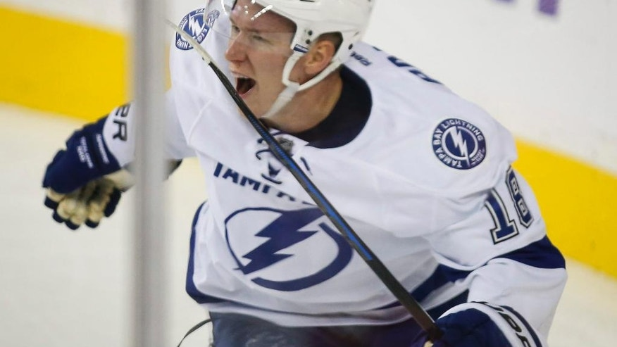 Tampa Bay Lightning's Ondrej Palat, from the Czech Republic, celebrates his overtime goal against the Calgary Flames in an NHL hockey game Tuesday, Oct. 21, 2014, in Calgary, Alberta. Tampa Bay won 2-1. (AP Photo/The Canadian Press, Jeff McIntosh)