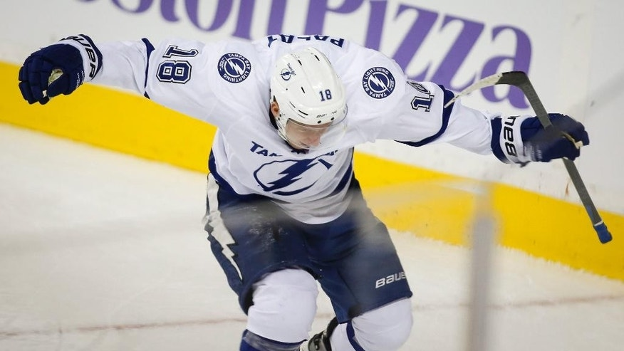 Tampa Bay Lightning's Ondrej Palat, from the Czech Republic, celebrates his overtime goal against the Calgary Flames during an NHL hockey game Tuesday, Oct. 21, 2014, in Calgary, Alberta. Tampa Bay won 2-1. (AP Photo/The Canadian Press, Jeff McIntosh)