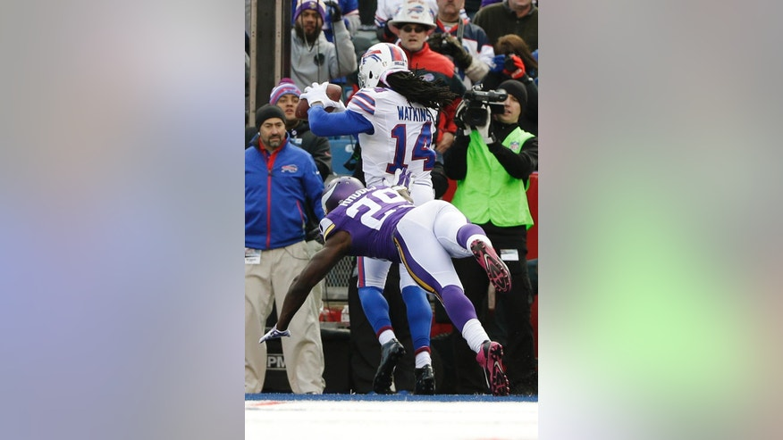 Buffalo Bills wide receiver Sammy Watkins (14) catches a pass for a touchdown in front of Minnesota Vikings cornerback Xavier Rhodes (29) during the second half of an NFL football game Sunday, Oct. 19, 2014, in Orchard Park, N.Y. The Bills won the game 17-16. (AP Photo/Bill Wippert)