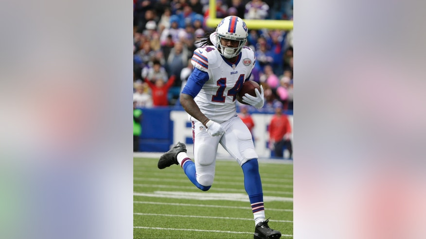 FILE - In this Oct. 19, 2014, file photo, Buffalo Bills wide receiver Sammy Watkins (14) runs with the ball after a catch during the first half of an NFL football game against the Minnesota Vikings in Orchard Park, N.Y.  The Bills gamble to give up their 2015 first-round draft pick in order to select receiver Sammy Watkins is showing early signs of paying off. (AP Photo/Bill Wippert, File)