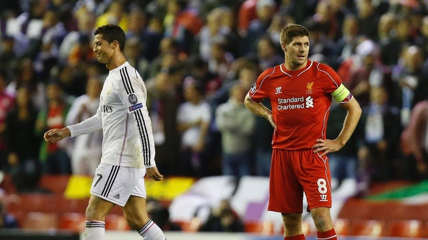 Real Madrid's Cristiano Ronaldo, left, walks past Liverpool's Steven Gerrard after Karim Benzema scored his side's third goal during the Champions League group B soccer match between Liverpool and Real Madrid at Anfield Stadium, Liverpool, England, Wednesday Oct. 22, 2014. (AP Photo/Jon Super)
