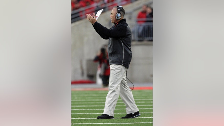 Rutgers head coach Kyle Flood instructs his team against Ohio State during the second quarter of an NCAA college football game Saturday, Oct. 18, 2014, in Columbus, Ohio. Ohio State won 56-17. (AP Photo/Jay LaPrete)