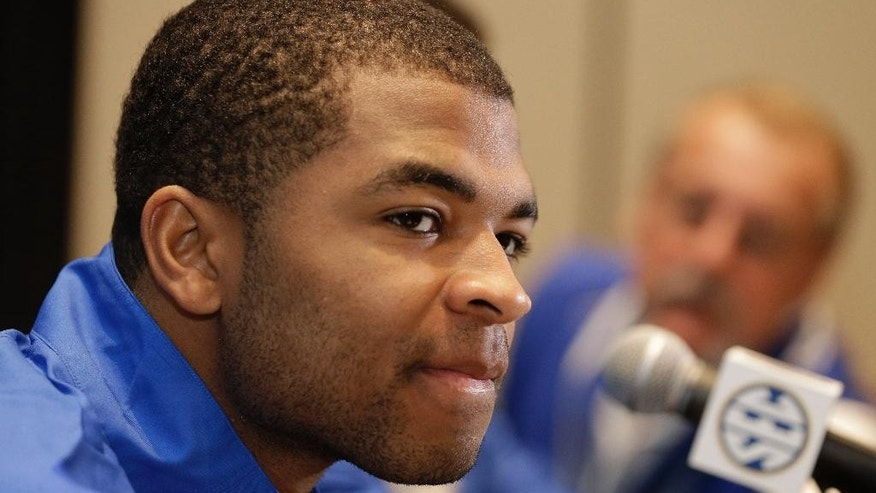 Kentucky's Aaron Harrison answers a question during a news conference at the Southeastern Conference NCAA men's college basketball media day in Charlotte, N.C., Wednesday, Oct. 22, 2014. (AP Photo/Chuck Burton)