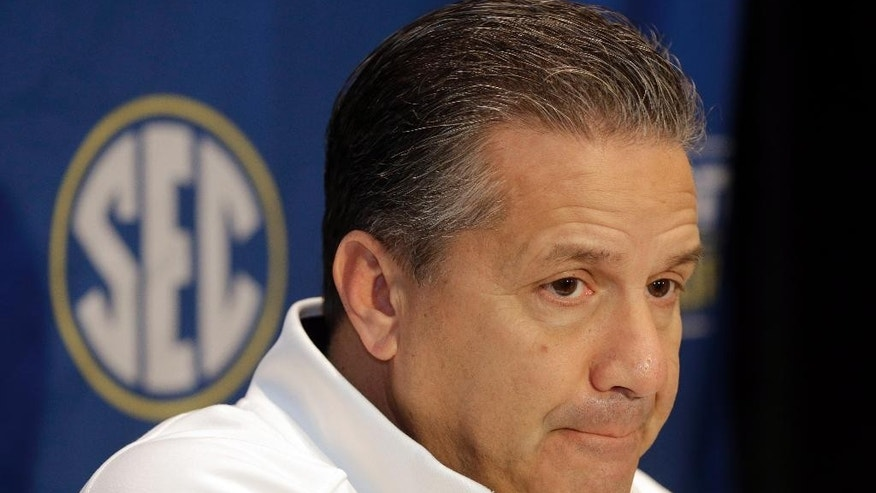 Kentucky head coach John Calipari listens to a question during a news conference at the Southeastern Conference men's NCAA college basketball media day in Charlotte, N.C., Wednesday, Oct. 22, 2014. (AP Photo/Chuck Burton)