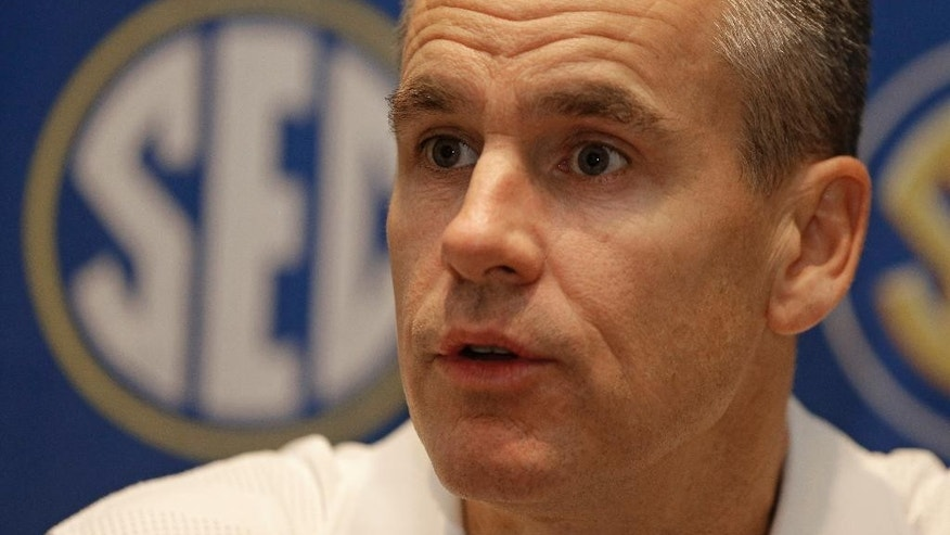 Florida head coach Billy Donovan answers a question during a news conference at the Southeastern Conference men's NCAA college basketball media day in Charlotte, N.C., Wednesday, Oct. 22, 2014. (AP Photo/Chuck Burton)