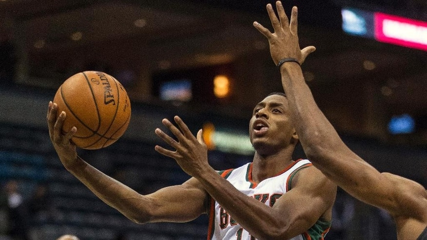 Milwaukee Bucks' Brandon Knight drives against a Minnesota Timberwolves defender during the first half of an NBA basketball game Wednesday, Oct. 22, 2014, in Milwaukee. (AP Photo/Tom Lynn)