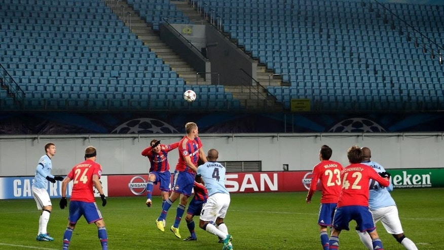 Manchester City players and CSKA players play in front of empty stands during the Group E Champions League soccer match between CSKA Moscow and Manchester City at Arena Khimki stadium in Moscow, Russia, Tuesday, Oct. 21, 2014. CSKA has to play 3 matches behind closed doors as punishment for the bad behaviour of their fans during the last season. (AP Photo/Pavel Golovkin)
