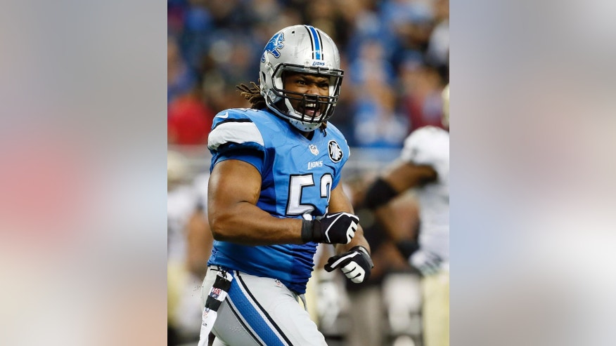 Detroit Lions defensive end Darryl Tapp (52) reacts after a play during the second half of an NFL football game against the New Orleans Saints in Detroit, Sunday, Oct. 19, 2014. (AP Photo/Paul Sancya)