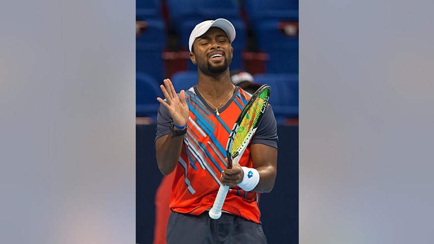 Donald Young of the US reacts during his match against Canada's Milos Raonic at the Swiss Indoors tennis tournament at the St. Jakobshalle in Basel, Switzerland, Oct. 23, 2014. (AP Photo/Keystone, Georgios Kefalas)