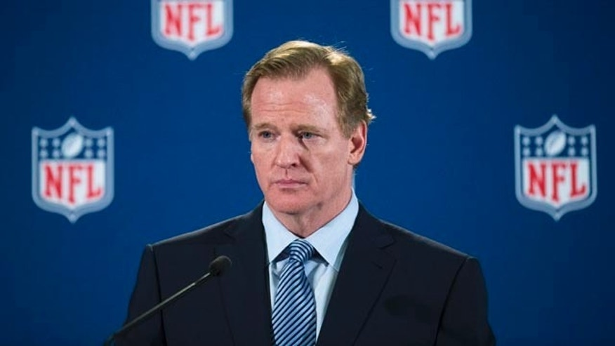 October 8, 2014: NFL Commissioner Roger Goodell speaks during a news conference following a meeting of NFL owners and executives in New York. (AP Photo/John Minchillo)